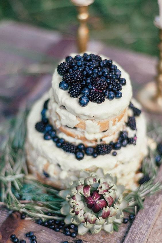semi naked wedding cake with blackberries and blueberries