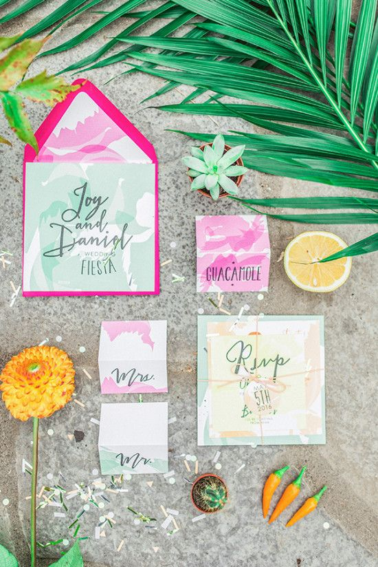 colorful watercolor wedding stationary with bold envelopes