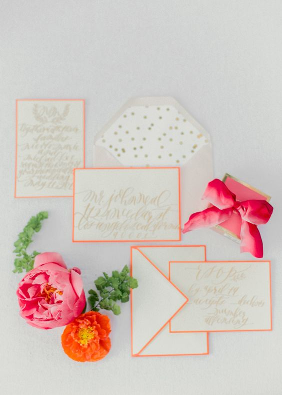 coral framing wedding stationary with polka dot lining