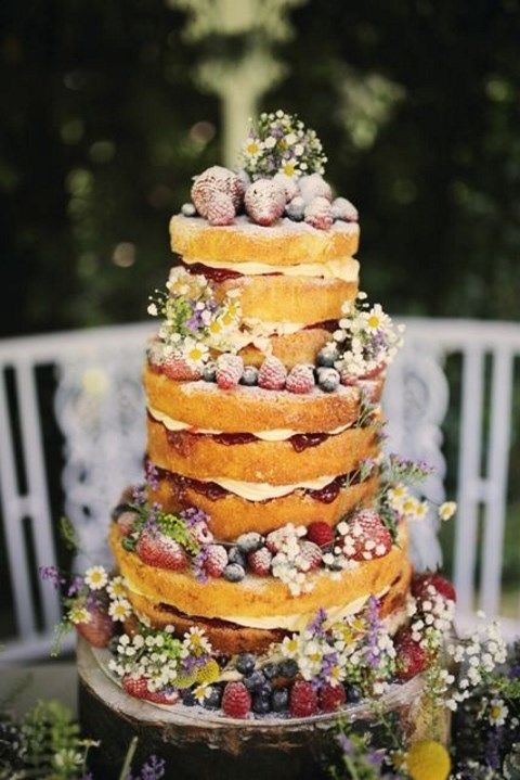 naked wedding cake with ripe berries, flowers looks veyr summer like