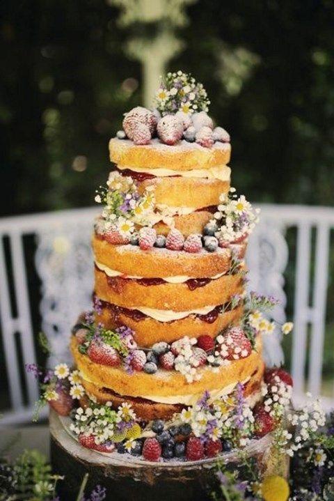 naked wedding cake with ripe berries, flowers looks veyr summer-like