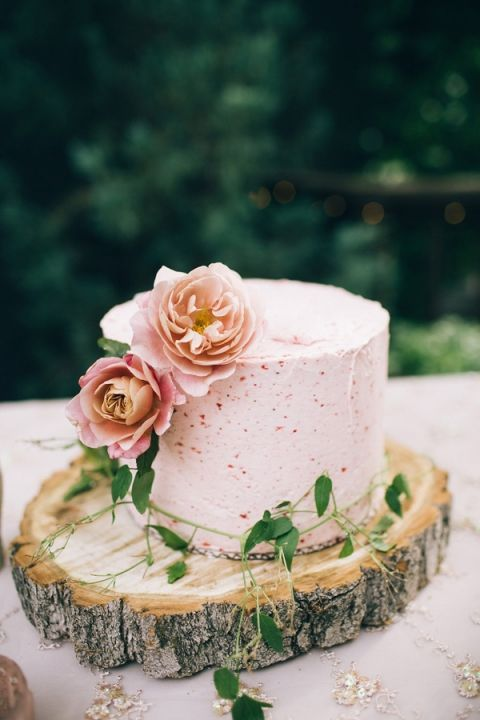rustic woodland summer wedding cake with summer berry frosting and blooms