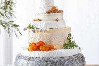 34 a rustic cheese tower on a stand, tomatoes, herbs, nuts and herbs