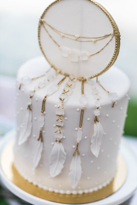 white dreamcatcher wedding cake is a stunning idea