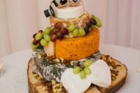 36 a cheese tower with grapes and mouse cake topeprs for fun