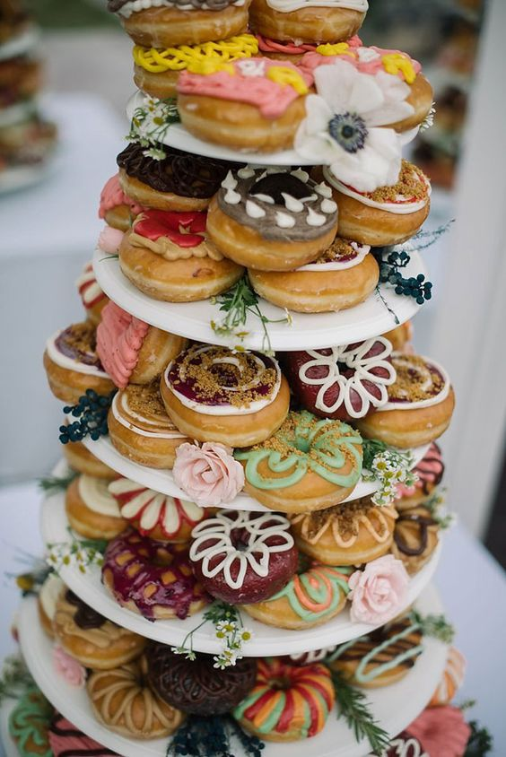 colorful glazed donut tower instead of a wedding cake