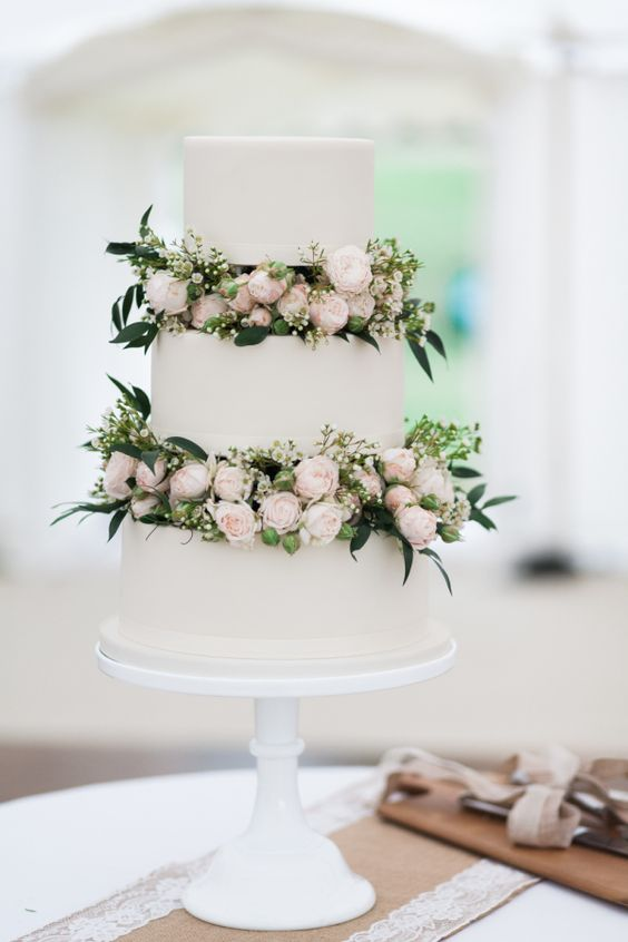 white wedding cake with blush garden roses and greenery