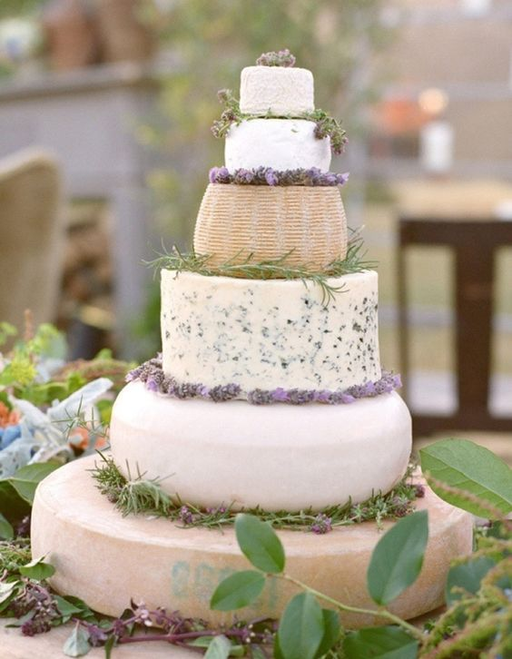 Provence inspired cheese tower with herbs and lavender looks delicious