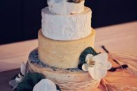 a cheese tower topped with white orchids for a tropical wedding