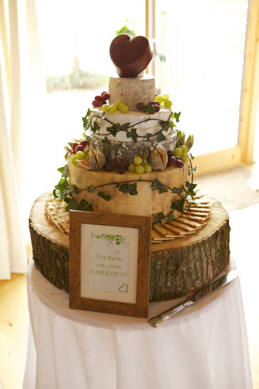 a rustic display with crackers, leaves and grapes