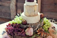 beautiful cheese tower with grapes and figs, a cheddar heart on top