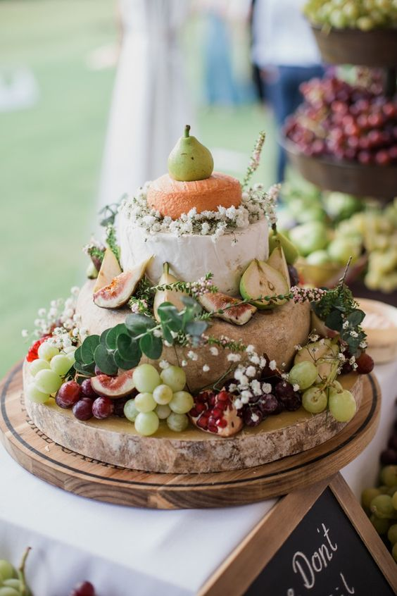 cute cheese tower with baby's breath, eucalyptus, grapes and pears
