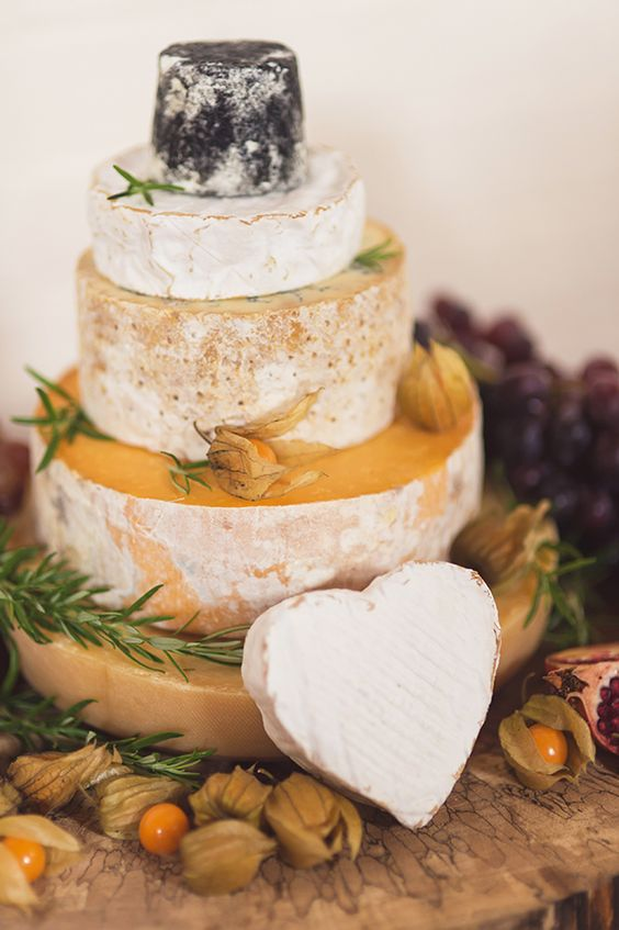 different types of cheese, greenery and a heart-shaped cheese piece