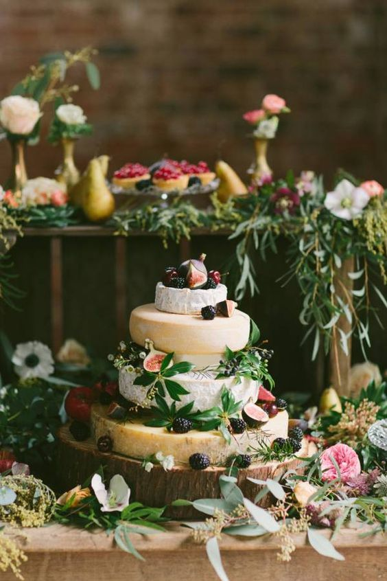 pretty cheese head display with blackberries, figs and green leaves