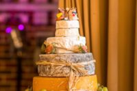 rustic cheese tower with straw, grapes, figs and mouse toppers