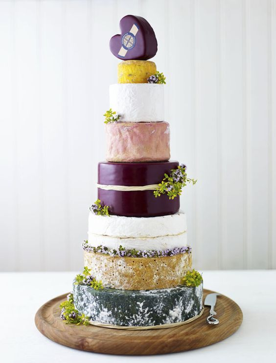 tall cheese tower with greenery and a heart-shaped cheese piece on top