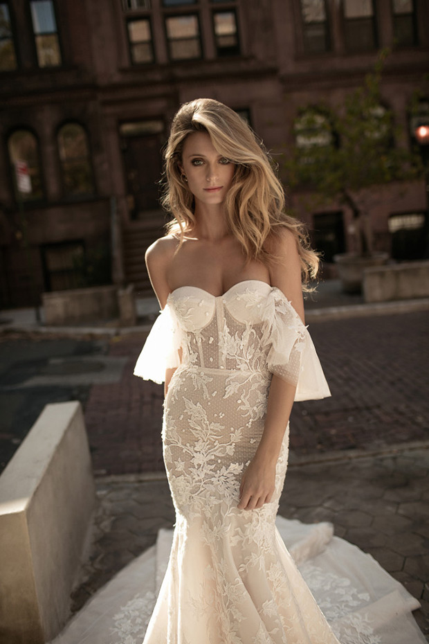 A bit sheer off the shoulder dress with floral lace appliques and a train