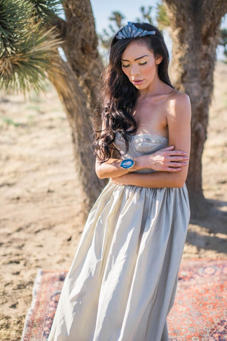 The bride was rocking a silver grey strapless wedding gown with a crystal corsage,crown and a bracelet