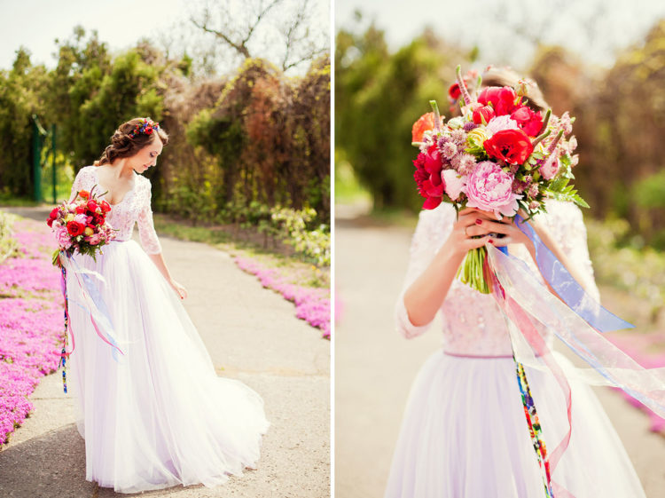 The bride was wearing a gorgeous lavender wedding dress with a flowy skirt and a lace bodice and a bold floral headpiece