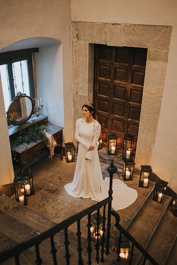 The bride was wearing a modern plain dress with a train and neckline decor and a tiara
