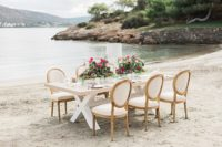 02 The table was laid on the sea shore, the colors were neutrals and the florals were bold pink ones