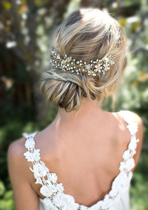 a beautiful low bun with twisted hair and a sparkling hair vine look great