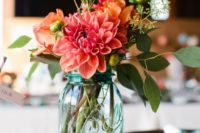 02 a blue mason jar with a colorful floral arrangement for a fall wedding