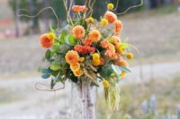 02 a tall vase with birch branches and a bold fall-inspired floral arrangement