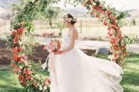 02 beautiful greenery and red flower wreath for an outdoor ceremony
