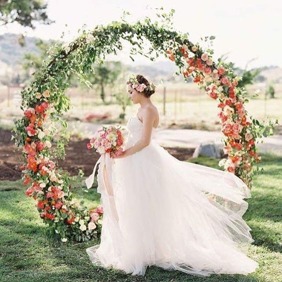 Beautiful Greenery And Red Flower Wreath For An Outdoor Ceremony