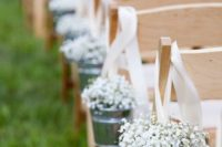 02 decorate your wedding aisle with small buckets of baby's breath