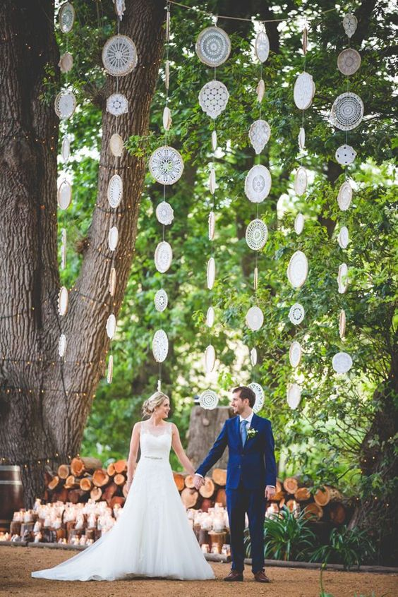 vertical doily garlands as a wedding backdrop