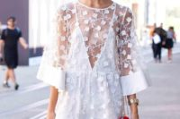 02 white botanical lace romper with an illusion plunging neckline and a bold red bag
