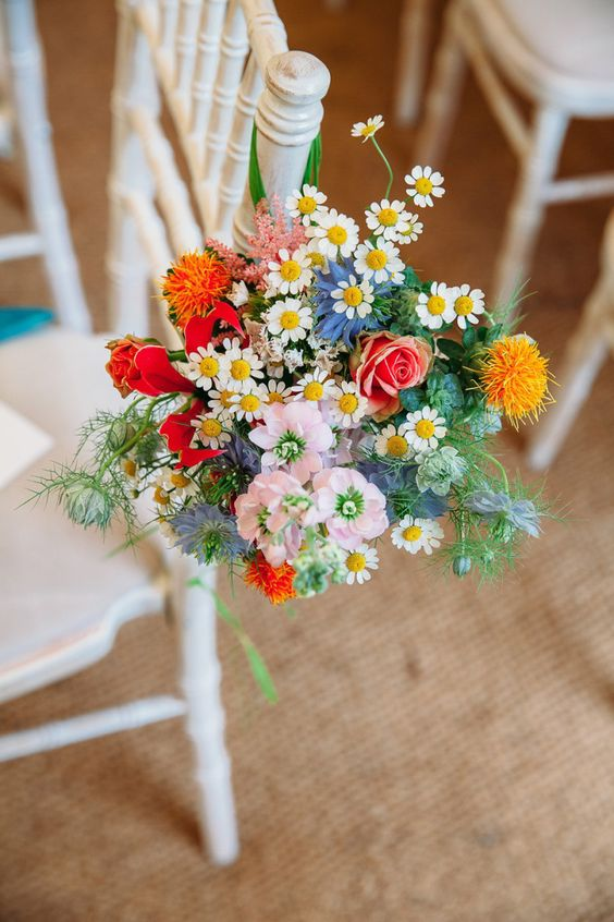 wildflower chair decor looks so pretty for summer weddings