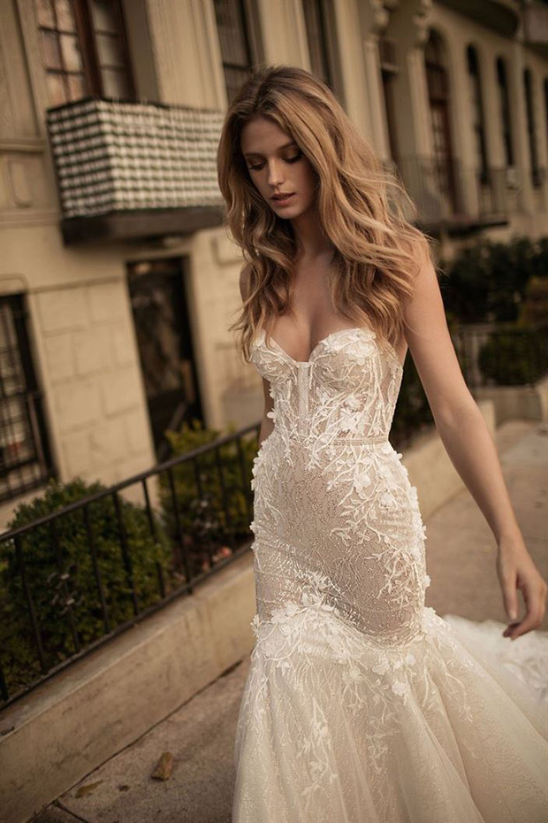 Daring strapless mermaid wedding dress with floral appliques and some bling