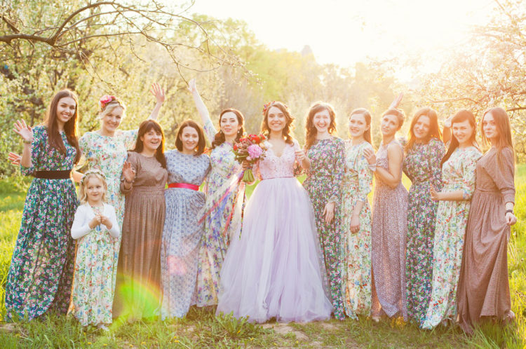 The bridesmaids were wearing mismatching floral maxi dresses