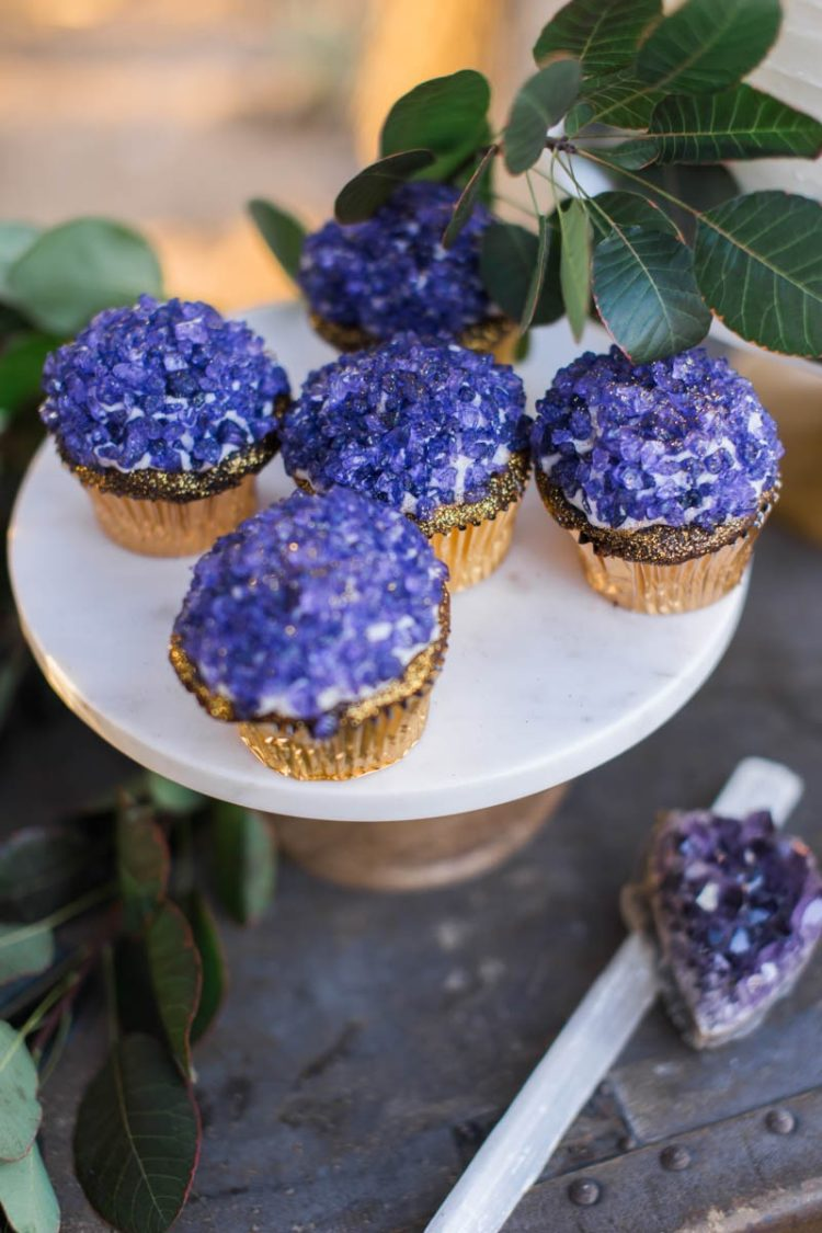 The wedding cupcakes were covered with purple edible crystals
