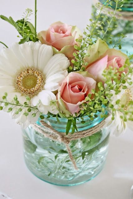 a blue mason jar with twine and simple florals for a spring or summer wedding