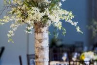 03 a tall vase wrapped with birch bark and with flowers on branches