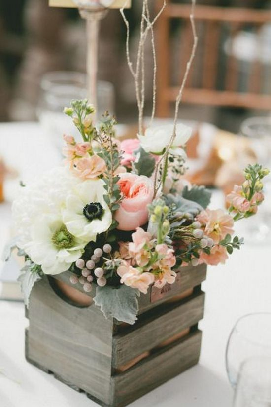 a wooden crate with fresh flowers is a simple and cute idea