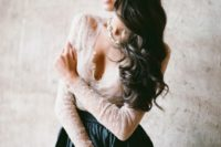 03 an ivory lace top with a V neckline and long sleeves and a black skirt