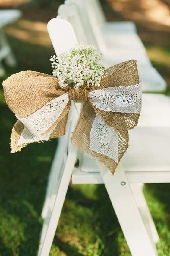 decorate the chairs with burlap and lace bows and baby's breath