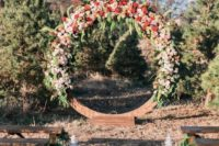 03 giant floral wreath wedding backdrop in red and blush tones for a winter ceremony