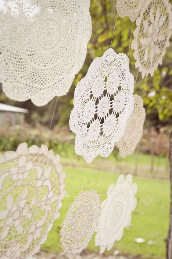romantic crochet doilies hanging as a backdrop