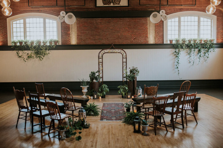 Black and white, exposed brick and lots of potted plants bcame a lively scene