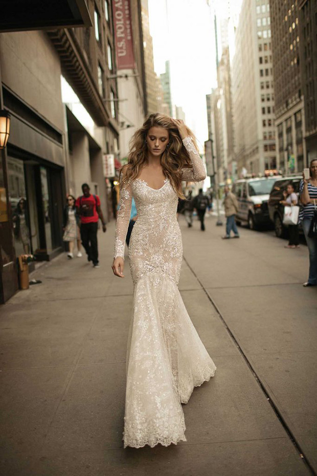 Mermaid illusion shoulder sparkling gown with a deep V neckline and lace appliques