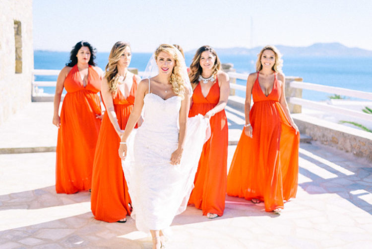 The bridesmaids were rocking bold orange maxi gowns