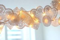 04 a doily garland with LEDs is a cute idea to highlight some area