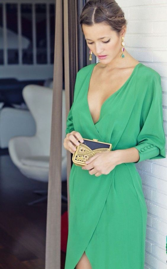 a green mavi dress with a plunging neckline, statement earrings and a cool clutch