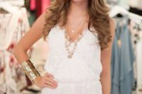 04 a white lace romper with spahetti straps and layered necklaces
